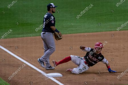 Alejandro Figueroa (12) of the Diablos Rojos  tags out by Manuel Valdez (18) of the Quintana Roo Tigres during the Mexican Baseball League match between the Diablos Rojos  and the Quintana Roo Tigres at Alfredo Harp Helu Stadium on June 11, 2021 in Mexico City, Mexico.