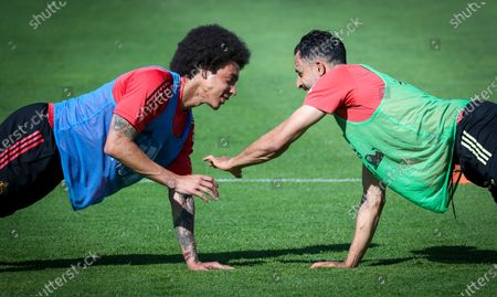 Belgium's Axel Witsel and Belgium's Nacer Chadli pictured during a training session of the Belgian national soccer team Red Devils, in Tubize, Monday 14 June 2021. The team is preparing for the secondbgame of the group phase of the Euro 2020 European Championship.
