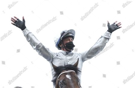 Stock Photo of Frankie Dettori celebrates after riding Palace Pier to victory during The Queen Anne Stakes (Group 1) on Day 1 of Royal Ascot