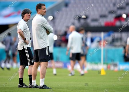 Germany's manager Joachim Loew, left, and team manager Oliver Bierhoff, right, attend a team training session at Allianz Arena stadium in Munich, the day before the Euro 2020 soccer championship group F match between France and Germany