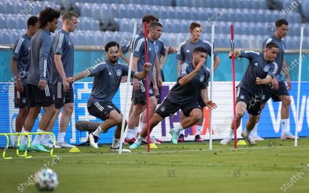 Germany's Ilkay Gundogan, fourth left, runs during a team training session at Allianz Arena stadium in Munich, the day before the Euro 2020 soccer championship group F match between France and Germany