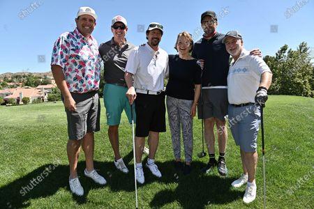 Pamela Reed, Joel McHale and the Morgan Stanley team