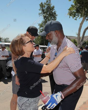 Pamela Reed and Dennis Haysbert