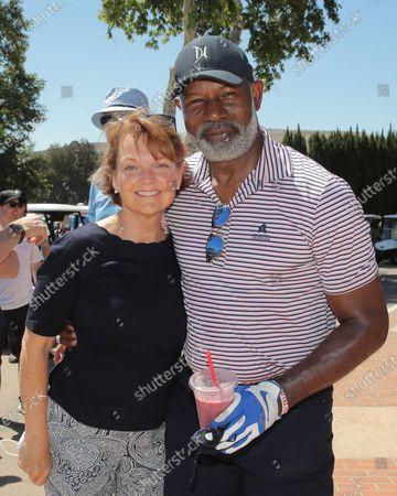 Stock Photo of Pamela Reed and Dennis Haysbert