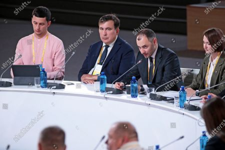 Stock Picture of Head of the Executive Committee of the National Reforms Council of Ukraine Mikheil Saakashvili and Minister of Infrastructure of Ukraine Oleksandr Kubrakov (L to R, middle) attend the Sailors, Anticorruption, Services for Sailors. Presentation of a Plan Aimed at Improving Public Services for Sailors and Overcoming Corruption in the Industry special session on the sidelines of the Ukraine 30. Economy Without Oligarchs Forum, Kyiv, capital of Ukraine.
