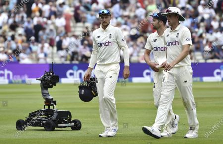 England captain Joe Root, left, England's Mark Wood and England's Olly Stone, right, during the third day of the 2nd Test match between England and New Zealand at Edgbaston cricket ground in Birmingham, England
