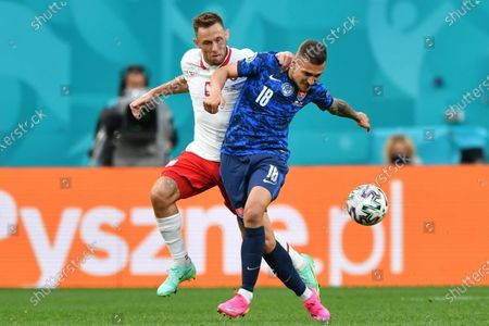 Stock Picture of Lukas Haraslin (R) of Slovakia in action against Maciej Rybus (L) of Poland during the UEFA EURO 2020 group E preliminary round soccer match between Poland and Slovakia in St. Petersburg, Russia, 14 June 2021.