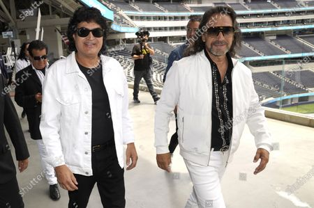 Members of the Mexican grupera band Los Bukis, Roberto Guadarrama, left, and Marco Antonio Solis attend a press conference at SoFi Stadium, in Inglewood, Calif. Twenty five years after their last show as a band, the group announced that they are reuniting for a U.S. tour