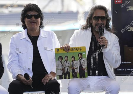 Stock Photo of Members of the Mexican grupera band Los Bukis Roberto Guadarrama, left, poses with Marco Antonio Solis as he holds a record at a press conference at SoFi Stadium, in Inglewood, Calif. Twenty five years after their last show as a band, the group announced that they are reuniting for a U.S. tour