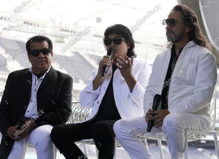 Members of the Mexican grupera band Los Bukis, from left, Pedro Sanchez, Roberto Guadarrama and Marco Antonio Solis attend a press conference at SoFi Stadium, in Inglewood, Calif. Twenty five years after their last show as a band, the group announced that they are reuniting for a U.S. tour