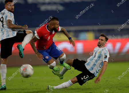 Argentina's Nicolas Tagliafico, right, fouls Chile's Arturo Vidal during a Copa America soccer match at the Nilton Santos stadium in Rio de Janeiro, Brazil