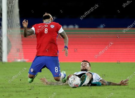 Chile's Arturo Vidal (L) is fouled by Argentina's Nicolas Otamendi during the Copa America group B preliminary round soccer match between Argentina and Chile at Olimpico Nilton Santos stadium in Rio de Janeiro, Brazil, 14 June 2021.