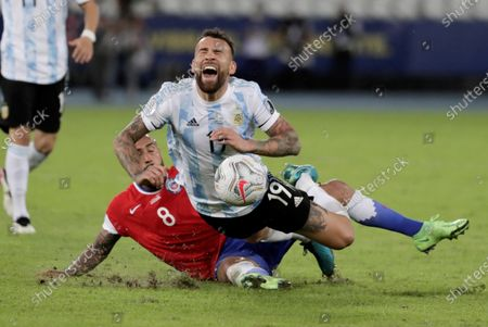 Argentina's Nicolas Otamendi (up) is fouled by Chile's Arturo Vidal during the Copa America group B preliminary round soccer match between Argentina and Chile at Olimpico Nilton Santos stadium in Rio de Janeiro, Brazil, 14 June 2021.