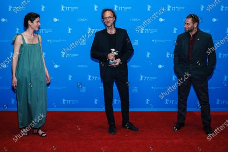 Stock Image of Director Denes Nagy (C), winner of the Silver Bear for Best Director, poses with Producers Marcell Gero (R) and Sara Laszlo (L) as they attend the premiere of 'Termeszetes feny' (Natural Light) during the 71st Berlin International Film Festival (Berlinale) Summer Special at the Museumsinsel (Museum Island) outdoor cinema in Berlin, Germany, 14 June 2021.The movie is presented in the festival's Official Competition. Due to the coronavirus COVID-19 pandemic, the 71st Berlinale is taking place in two stages: a virtual Industry Event, that was held from 01 to 05 March 2021, and the Summer Special for the general public running from 09 to 20 June 2021 as an outdoor-only event.