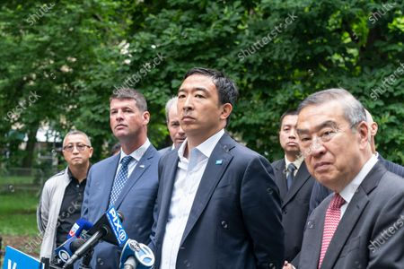 Stock Picture of Mayoral candidate Andrew Yang receives endorsement by Captains Endowment Association and the Asian-American Police Executive Council at City Hall Park. To Andrew Yang left is AAPEX Advisory Board Chairman and former NYPD Deputy Commissioner-Trials Hugh Mo, to Yang right is Captains Endowment Association President Christopher Monahan. As Chris Monahan said â€oeCrime is getting worse in New York and we need a clean break from the politicians and insiders who got us into this situationâ€oe.