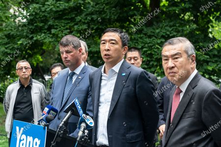 Stock Image of Mayoral candidate Andrew Yang receives endorsement by Captains Endowment Association and the Asian-American Police Executive Council at City Hall Park. To Andrew Yang left is AAPEX Advisory Board Chairman and former NYPD Deputy Commissioner-Trials Hugh Mo, to Yang right is Captains Endowment Association President Christopher Monahan. As Chris Monahan said â€oeCrime is getting worse in New York and we need a clean break from the politicians and insiders who got us into this situationâ€oe.