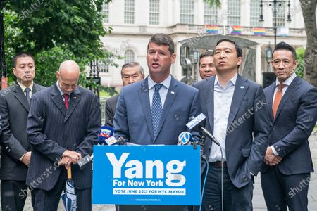 President of CEA Chris Monahan speaks at mayoral candidate Andrew Yang endorsement by Captains Endowment Association and the Asian-American Police Executive Council at City Hall Park in New York on June 14, 2021. To Chris Monahan right is AAPEX Advisory Board Chairman and former NYPD Deputy Commissioner-Trials Hugh Mo, to Monahan left is mayoral candidate Andrew Yang. As Chris Monahan said â€oeCrime is getting worse in New York and we need a clean break from the politicians and insiders who got us into this situationâ€oe.