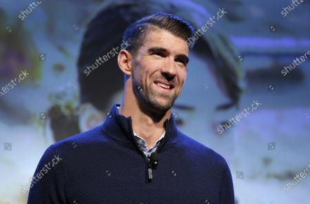 Michael Phelps speaks during a Panasonic news conference before the CES tech show in Las Vegas. It is June 2021 in an Olympic year, and Phelps is feeling it. In his mind and in his body. Except the winningest Olympian of all time has been retired for five years