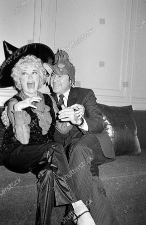 Stock Photo of UNITED STATES - OCTOBER 30:  Phyllis Diller and Dr. Donald Levy