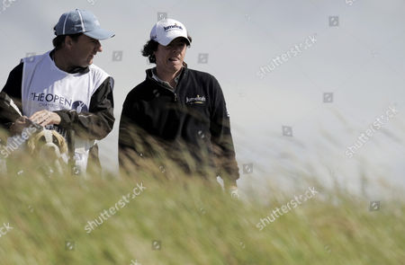 Rory McIlroy of Northern Ireland talks with his caddie J P Fitzgerald
