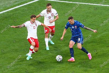Karol Linetty (POL)  Maciej Rybus (POL)  Lukas Haraslin (SVK) during the UEFA EURO 2020 Group E football match between Poland and Slovakia at the Saint Petersburg Stadium in Saint Petersburg, Russia on June 14, 2021.