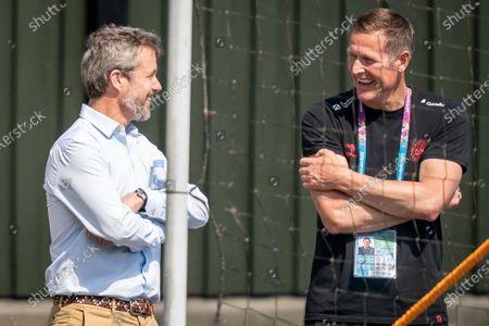 Denmark's Crown Prince Frederik (L) talks to DBU director Peter Moeller (R) during the national soccer team training session in Elsinore, Denmark, 15 June 2021. Denmark will face Belgium on 17 June 2021 in group B of EURO2020.