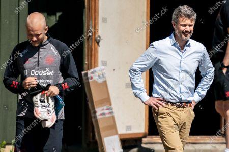 Denmark's player Nicolai Boilesen (L) and Danish Crown Prince Frederik (R) during the national soccer team training session in Elsinore, Denmark, 15 June 2021. Denmark will face Belgium on 17 June 2021 in group B of EURO2020.