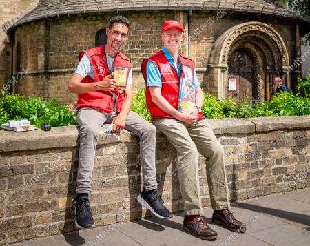 Justin Welby, The Archbishop of Canterbury,(right) selling the Big Issue in Cambridge on Thursday afternoon with local seller Lee.