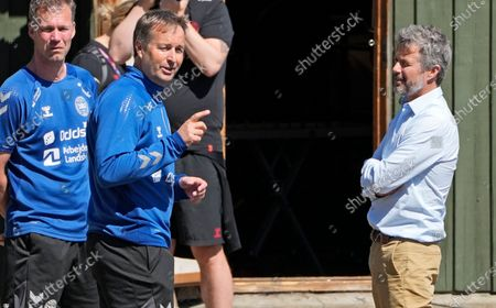 Crown Prince Frederik of Denmark, right, listens to Denmark's manager Kasper Hjulmand, left, during a training session of Denmark's national team in Helsingor, Denmark, . It is the second training of the Danish team since the Euro championship soccer match against Finland when Christian Eriksen collapsed last Saturday