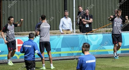Crown Prince Frederik of Denmark, center, smiles as he watches the Danish players during a training session of Denmark's national team in Helsingor, Denmark, . It is the second training of the Danish team since the Euro championship soccer match against Finland when Christian Eriksen collapsed last Saturday