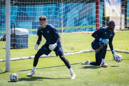 Switzerland's goalkeeper Gregor Kobel (L) and Switzerland's goalkeeper Yvon Mvogo (R) in action during a training session for the Euro 2020 soccer tournament at the Tre Fontane sports centre, in Rome, Italy, 15 June 2021. The Swiss national soccer team will face Italy in Group A on 16 June 2021 during the UEFA EURO 2020 soccer championship in Rome, Italy.