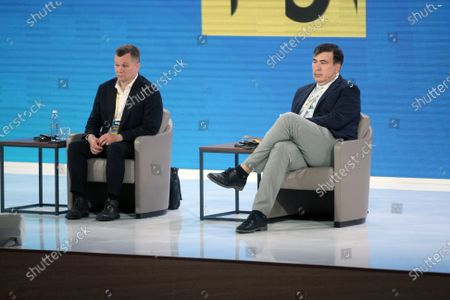 Stock Image of President of the Kyiv School of Economics, advisor to the Head of the Office of the President of Ukraine Tymofiy Mylovanov and head of the Executive Committee of the National Reforms Council of Ukraine Mikheil Saakashvili (L to R) attend the Countering Oligarch Influence session on Day Two of the Ukraine 30. Economy Without Oligarchs in Kyiv, capital of Ukraine.