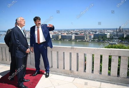 Portugal's President Marcelo Rebelo de Sousa (L) and his Hungarian counterpart Janos Ader (R), during their meeting on the terrace of the presidential Alexander Palace in Budapest, Hungary, 15 June 2021.