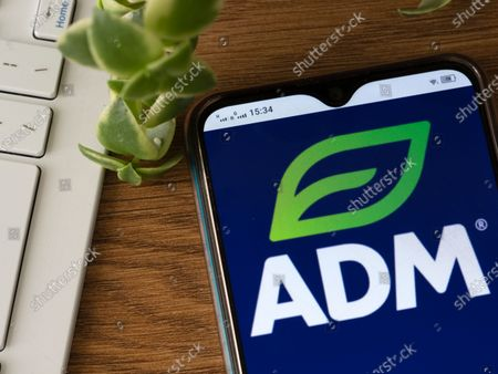 In this photo illustration an Archer Daniels Midland Company logo seen displayed on a smartphone.