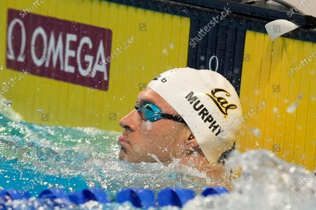 Ryan Murphy checks his time after winning his semifinal heat in the men's 100-meter backstroke during wave 2 of the U.S. Olympic Swim Trials, in Omaha, Neb
