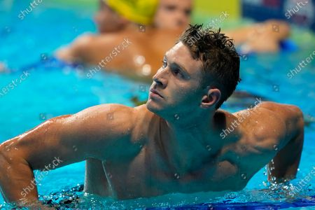 Ryan Murphy climbs out of the pool after winning his semifinal heat in the men's 100-meter backstroke during wave 2 of the U.S. Olympic Swim Trials, in Omaha, Neb