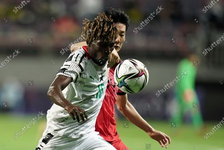 Stock Picture of Boakye Samuel of Ghana competes for the ball with Kim Jin-ya of South Korea during U-24 international friendly soccer match between South Korea and Ghana at the Jeju World Cup Stadium in Jeju, South Korea, 15 June 2021.