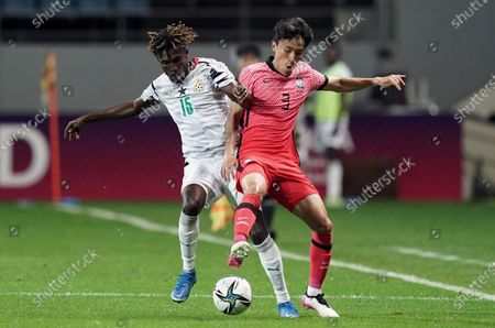 Stock Photo of Boakye Samuel of Ghana competes for the ball with Kim Jin-ya of South Korea during U-24 international friendly soccer match between South Korea and Ghana at the Jeju World Cup Stadium in Jeju, South Korea, 15 June 2021.