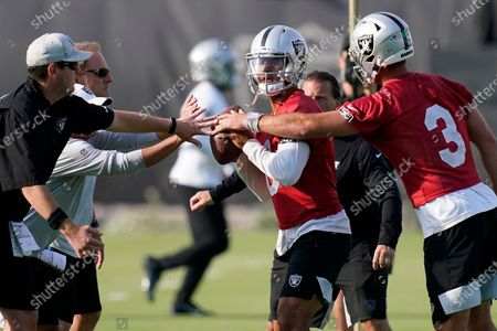 Stock Picture of Las Vegas Raiders quarterback Marcus Mariota, center, takes part in a drill during an NFL football practice, in Henderson, Nev
