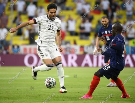 France's N'Golo Kante, right, challenges Germany's Ilkay Gundogan during the Euro 2020 soccer championship group F match between Germany and France at the Allianz Arena stadium in Munich