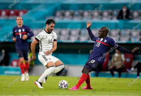 Germany's Ilkay Gundogan, left, battles for the ball with France's N'Golo Kante during the Euro 2020 soccer championship group F match between France and Germany at the Allianz Arena in Munich, Germany