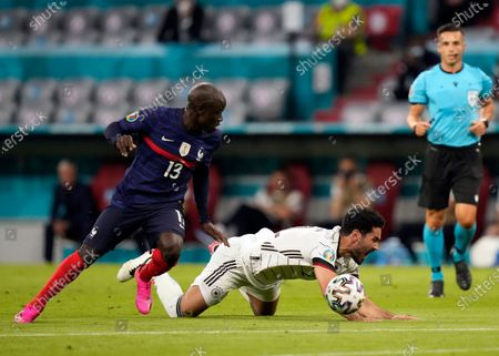 Germany's Ilkay Gundogan, right, battles for the ball with France's N'Golo Kante during the Euro 2020 soccer championship group F match between France and Germany at the Allianz Arena in Munich, Germany