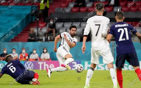 Germany's Ilkay Gundogan, centre, shoots during the Euro 2020 soccer championship group F match between France and Germany at the Allianz Arena in Munich, Germany