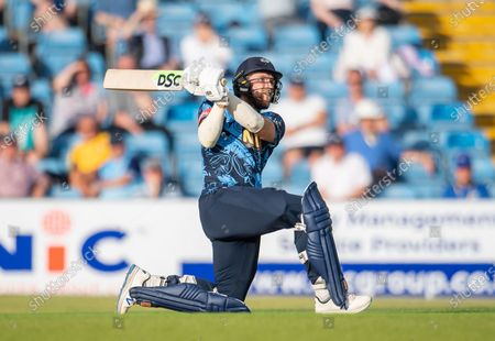 Yorkshire's David Willey hits a six against the Leicestershire Foxes.