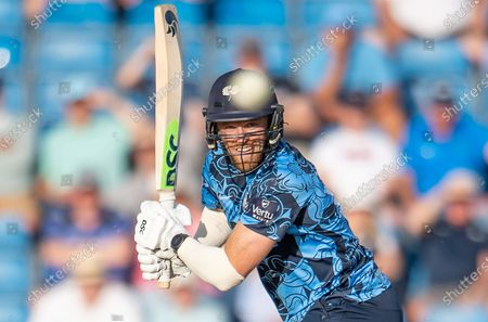 Stock Photo of Yorkshire's David Willey hits out against the Leicestershire Foxes.