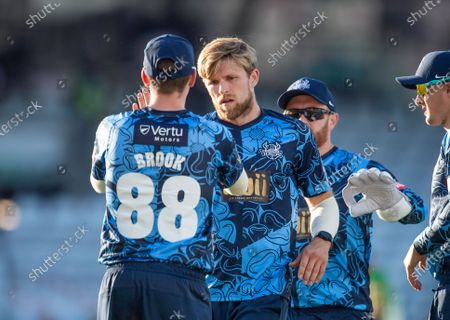 Yorkshire's David Willey is congratulated on dismissing  Leicestershire Foxes Scott Steel.