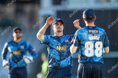 Yorkshire's Jordan Thompson congratulates Harry Brook on taking a catch from the bowling of David Willey to dismiss Scott Steel of the Leicestershire Foxes.