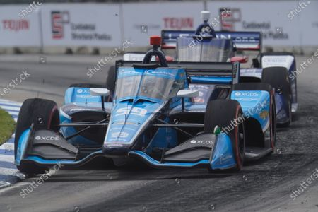 Max Chilton, of England, races during the first race of the IndyCar Detroit Grand Prix auto racing doubleheader on Belle Isle in Detroit
