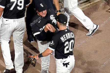 Stock Photo of Chicago White Sox manager Tony La Russa, left, greets Danny Mendick after the team's 3-0 win over the Tampa Bay Rays in a baseball game, in Chicago