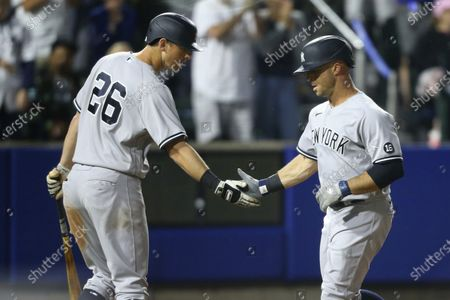 New York Yankees Brett Gardner right, celebrates his home run with teammate DJ LeMahieu during the seventh inning of a baseball game against the Toronto Blue Jays, in Buffalo, N.Y